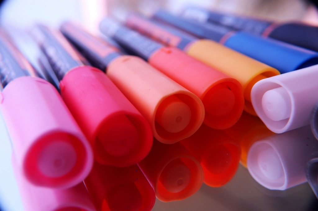 brightly colored markers close up
