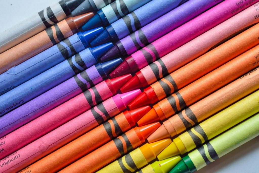 Rainbow crayons nestled together in a row - printable giraffe pages to color