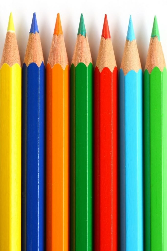 sharpened colored pencils in a row