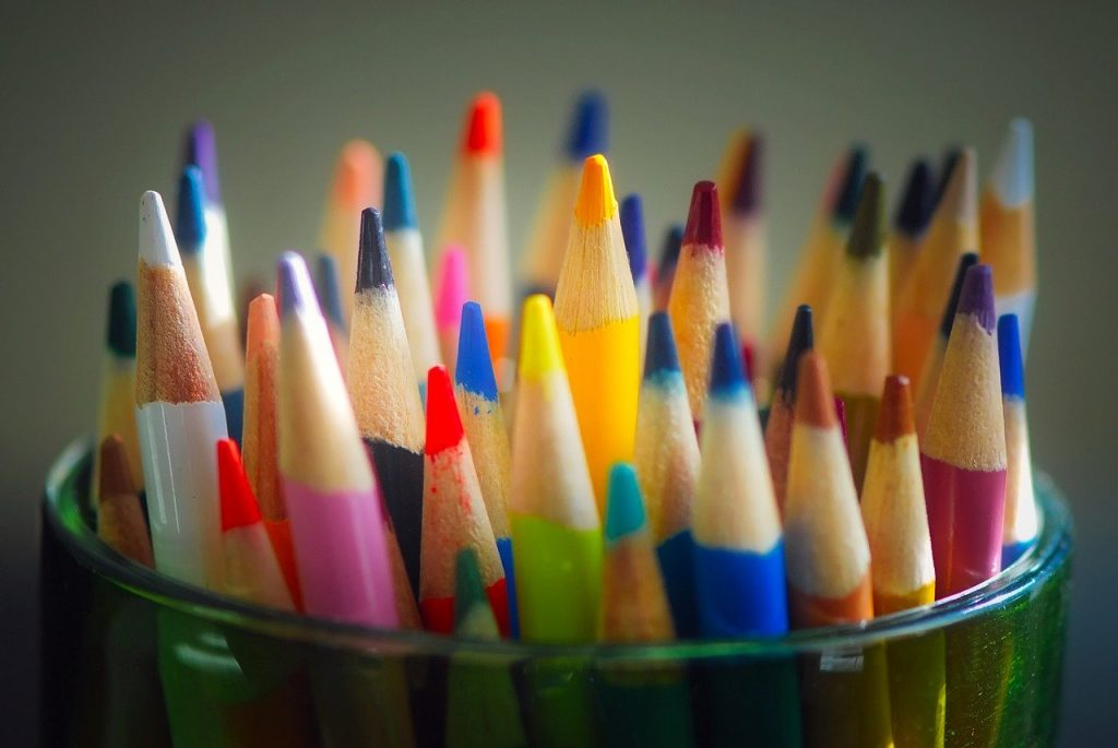 Sharpened colored pencils in glass jar