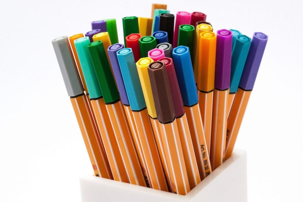 colored pencils in a white pencil holder - pictures of dragons to color