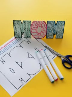 Wow Mom printable card with markers and scissors on yellow background