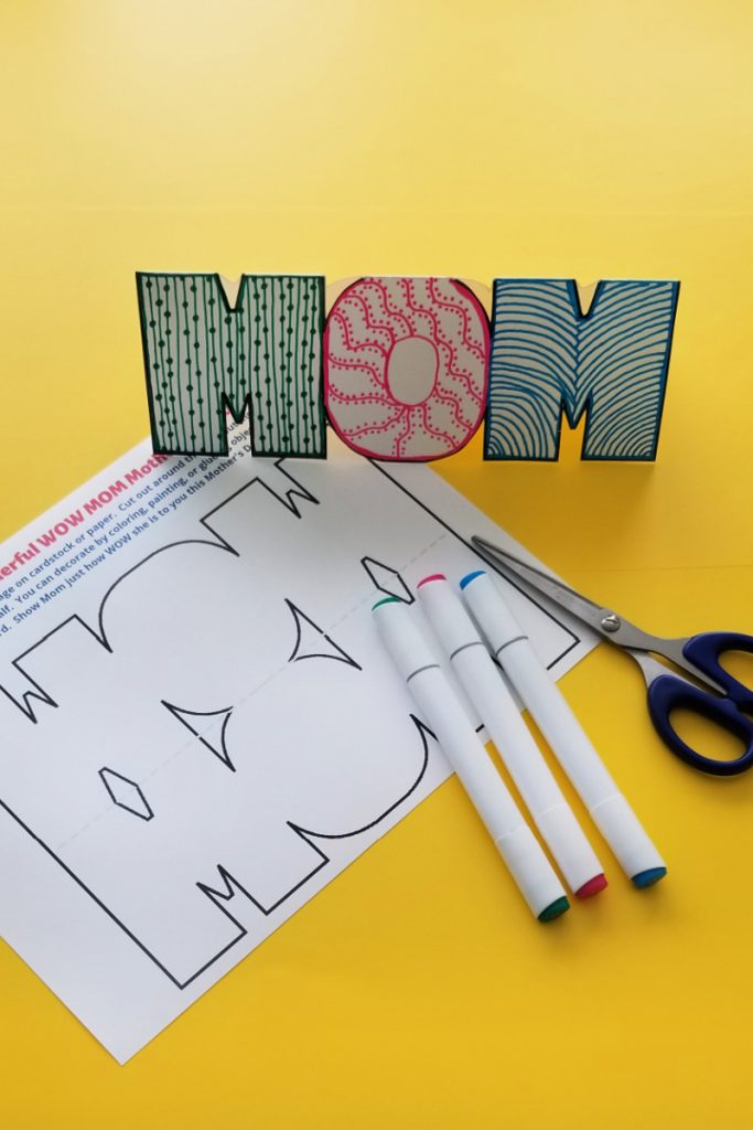 Wow Mom free printable Mothers Day card with scissors and markers on yellow background