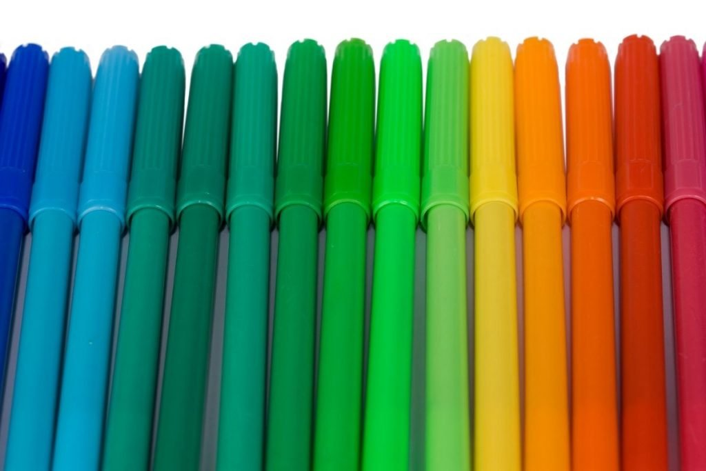 Row of markers on white background