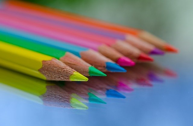 Neon colored pencils in a row with sharpened points