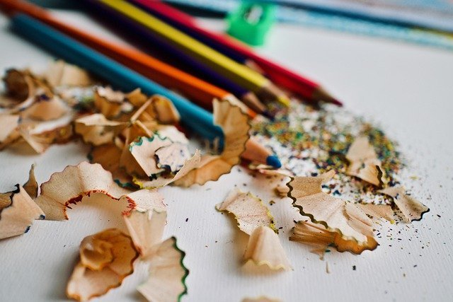 Colored pencils and shavings from pencil sharpener