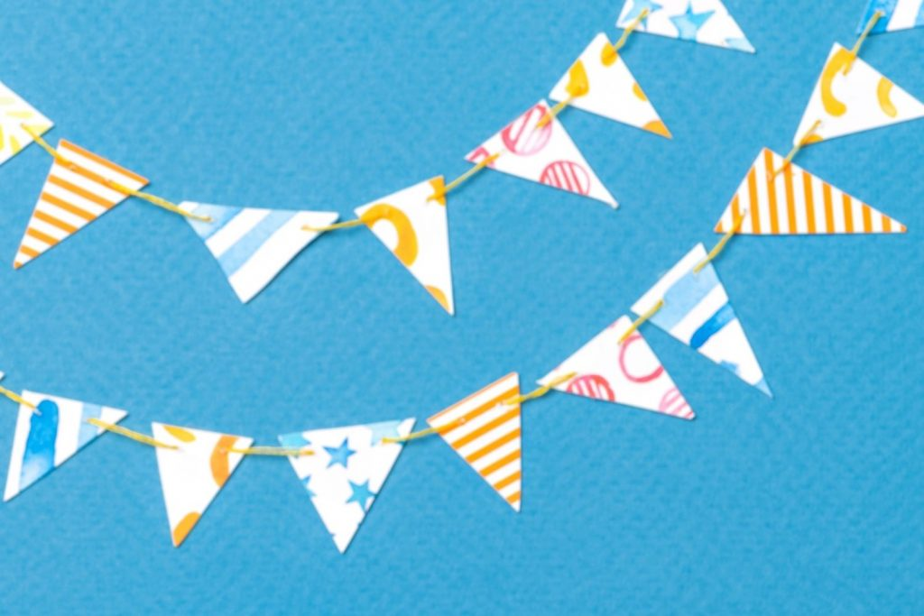 Paper garland on blue background - diy paper crafts