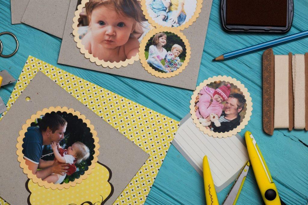 Scrapbooking paper photos and scissors