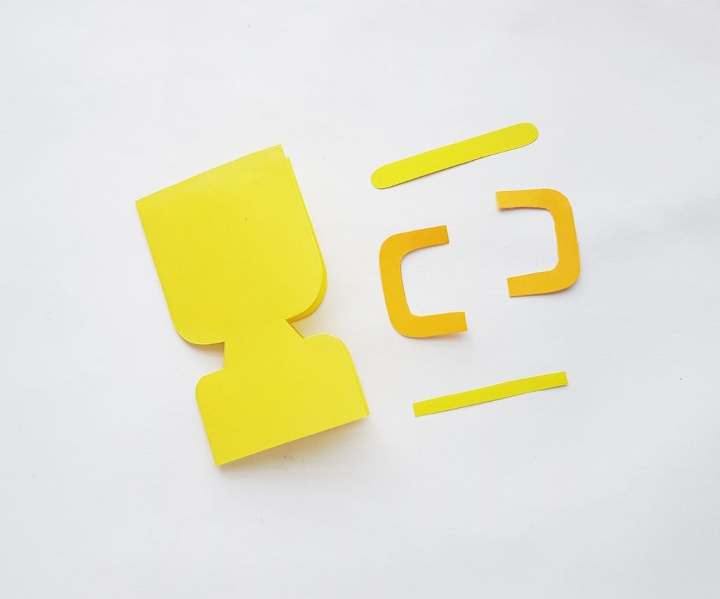 Cut out shapes of yellow and gold cardstock on white background - step 3