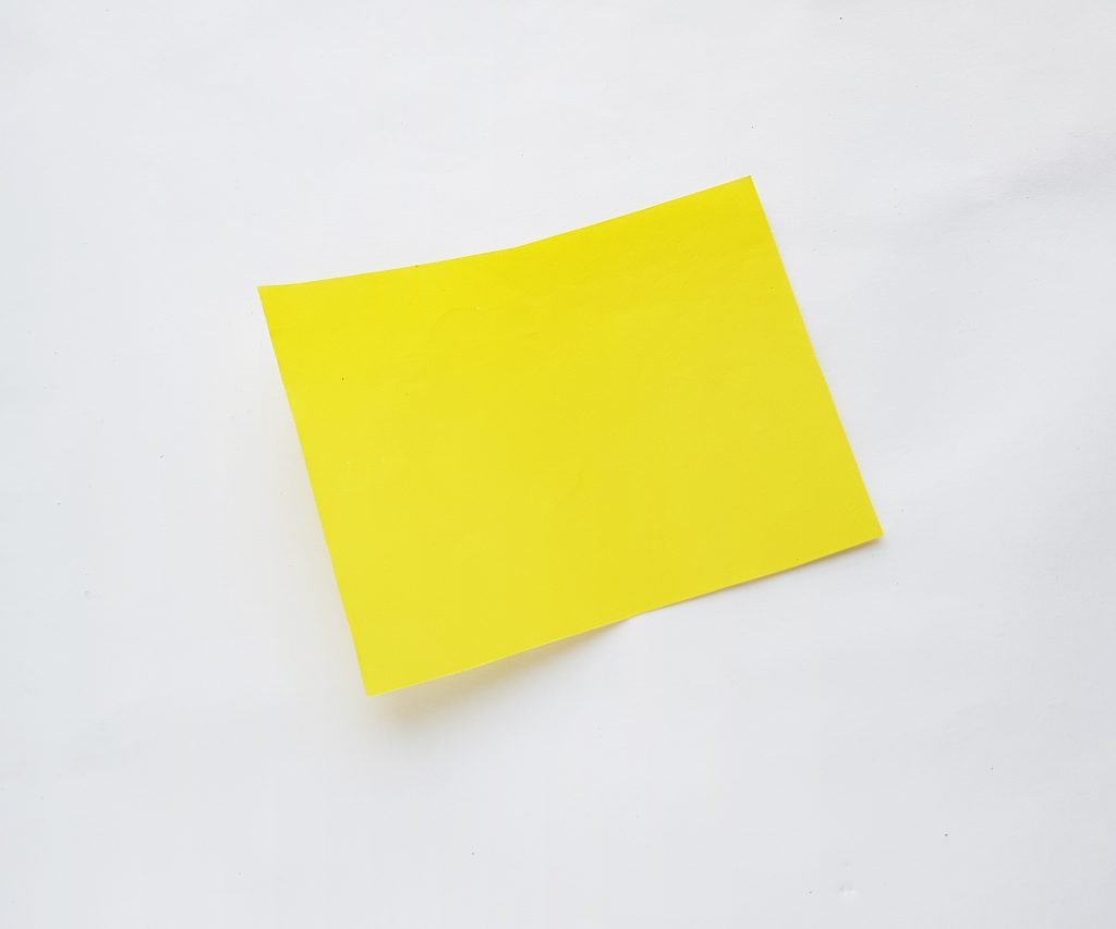 Yellow cardstock on white background - step 1 of fathers day trophy card