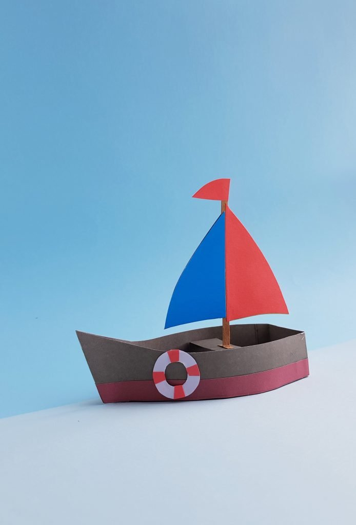 completed red blue and brown paper boat - how to make a boat from paper