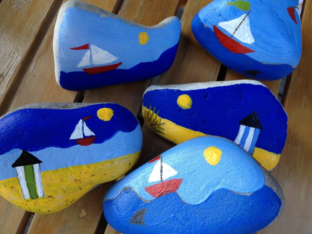 painted rocks with boats and sea scenes