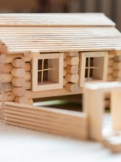 wood building toy shaped into log cabin